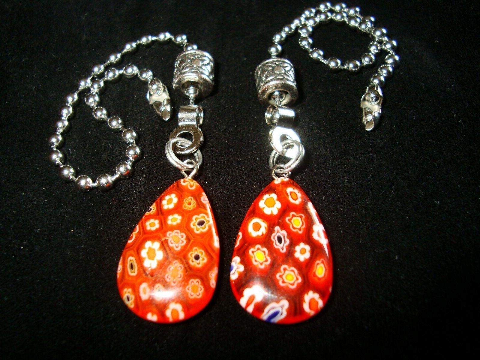 a pair of red millefiori glass ceiling